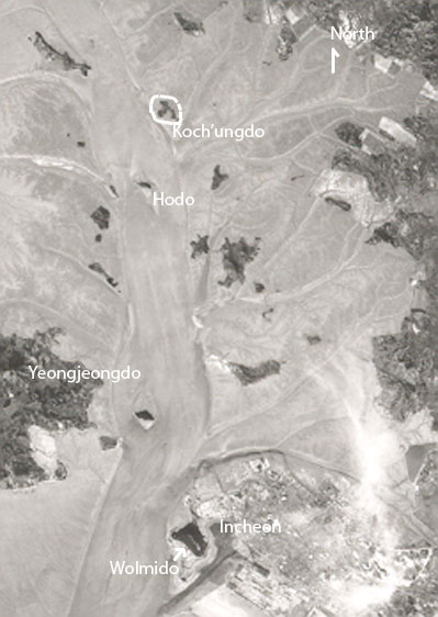 A 1968 CORONA spy-satellite photo of the area around Incheon, before the surrounding islands were reclaimed from the sea. Koch'umdo is circled.